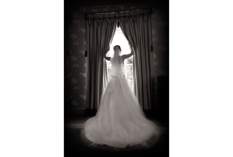 bride opening curtains